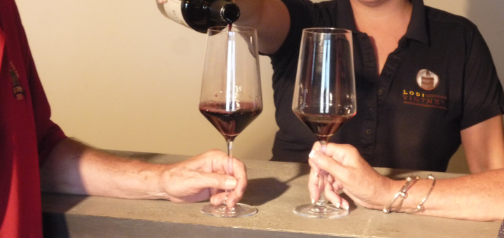 Brooke pouring wine